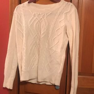 Cream colored cable knit sweater